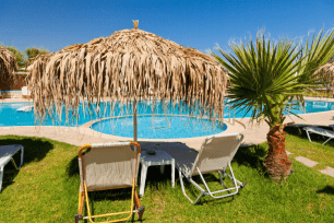 beach chairs by a pool all inclusive resort vacations