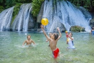 kids playing in water jamaica